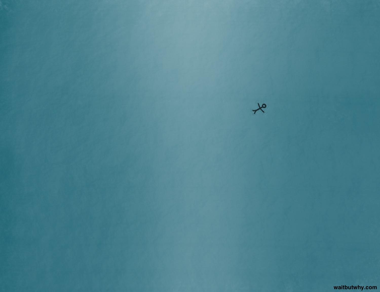 bird's-eye-view of tiny stick figure floating in vast ocean
